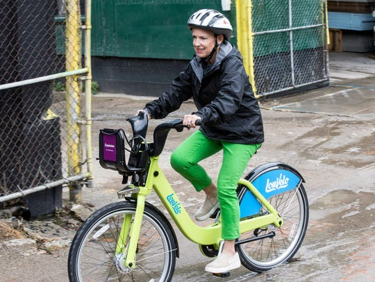 Kirby Adams takes one of the LouVelo Bikeshare cycles