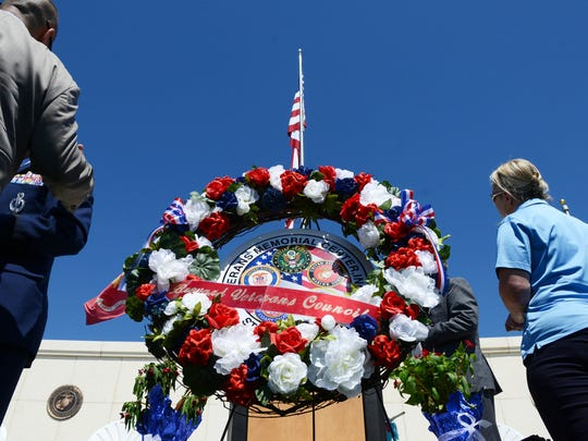 A wreath from Brevard Veterans Council sits near the