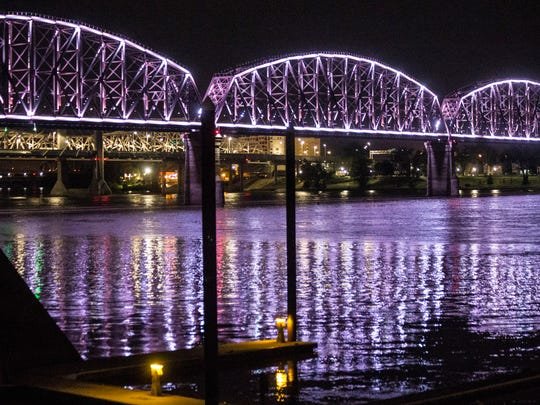 The lights of the Big Four Bridge lit up the Ohio River late Monday night. May 29, 2017