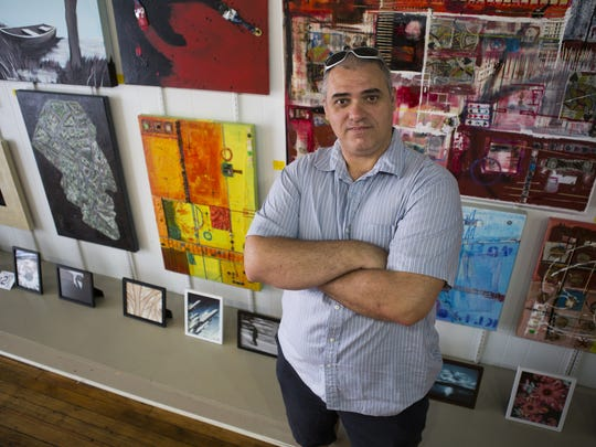 Griffin Moores/The News Leader Ivan Pesic, who recently opened up a new art gallery and coffee shop called Rooster Art and Coffee on East Beverley Street, stands inside his business on Tuesday. Ivan Pesic, who recently opened up a new art gallery and coffee shop called Rooster Art and Coffee on East Beverley Street, stands inside his business on Tuesday.