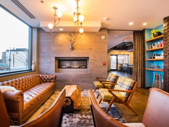 The lobby at The Oxbow Hotel in Eau Claire is decked out in rustic-chic mid-century modern furniture.