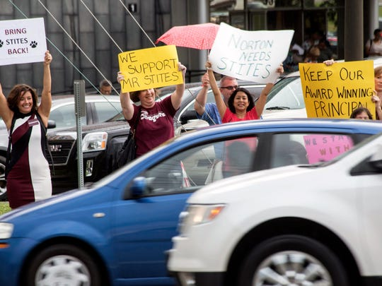 Cars honk in support of the parents and students assembled