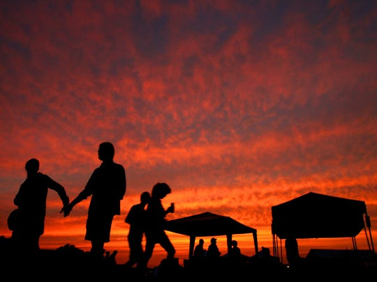 The sun sets over the festival field at the Hill Country Picnic. The festival celebrates the legacies of departed North Mississippi blues legends and it features some of their children and grandchildren.