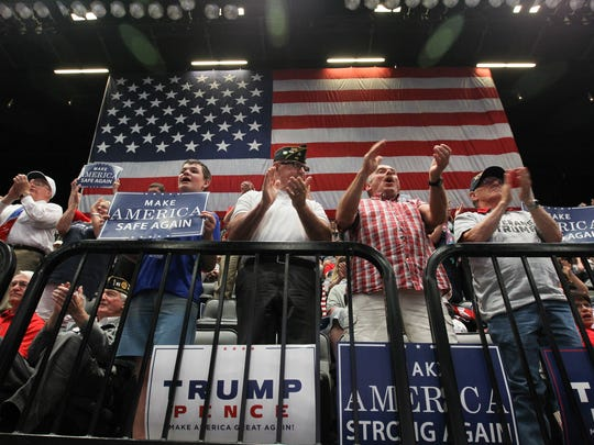 Supporters applaud President Donald Trump as he speaks to guests at the U.S. Cellular Center in Cedar Rapids on Wednesday, June 21, 2017.