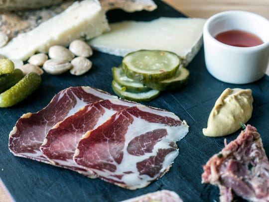 The charcuterie board at Red Hog offers a mix of cheeses