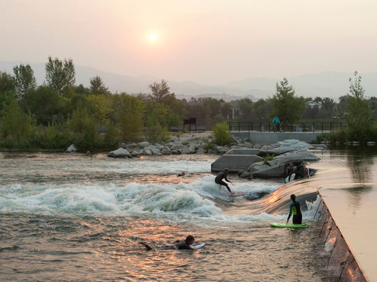 River surfers catch waves on Boise River following
