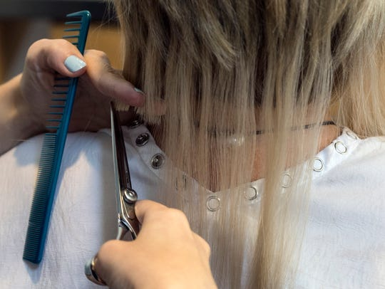 Once the hair extensions are complete, scissors are