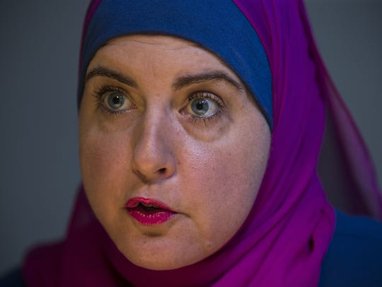 Deedra Abboud answers questions during an interview,