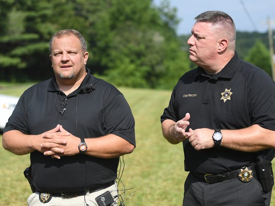 Capt. Jeremy Queen with the Transylvania County Sheriff's Office, left, and Jason Brown, chief deputy with the Henderson County Sheriff's Office, gave a press conference Tuesday announcing changes in the manhunt for Phillip Michael Stroupe II, who led police on a chase on Saturday and fled into the forest. The man, who is believed to be armed and dangerous, was spotted along Mills River Road Monday night by a motorist and the search perimeter has shifted into that area.