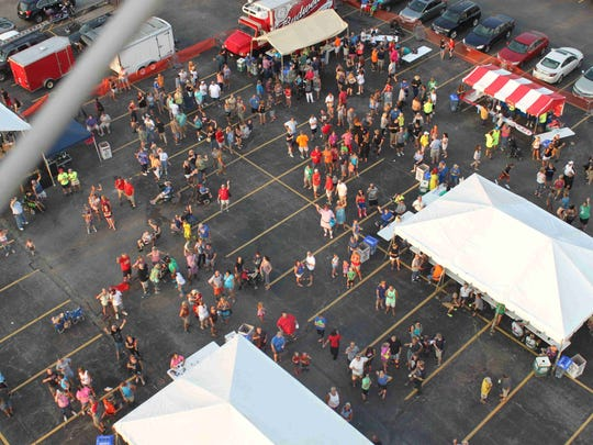 An aerial view of the crowd gathered for the sixth annual Delhi Skirt Game Tailgate Party in the lot at Remke Market. This year's tailgate party will be Aug. 3.