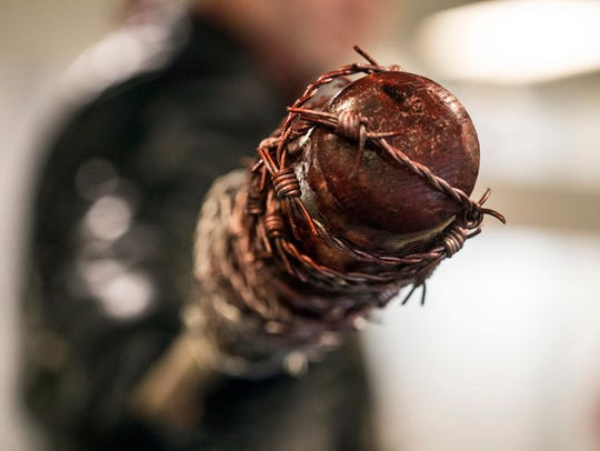 A bloody replica of Negan's bat from The Walking Dead
