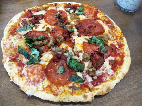 A thin crust pizza at Pie Five Pizza Co. Personal pizzas are customized from a lineup of 40 fresh toppings, seven sauces and five crusts, then baked in only 5 minutes.