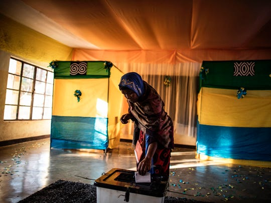 A Rwandan woman casts her vote at a polling station