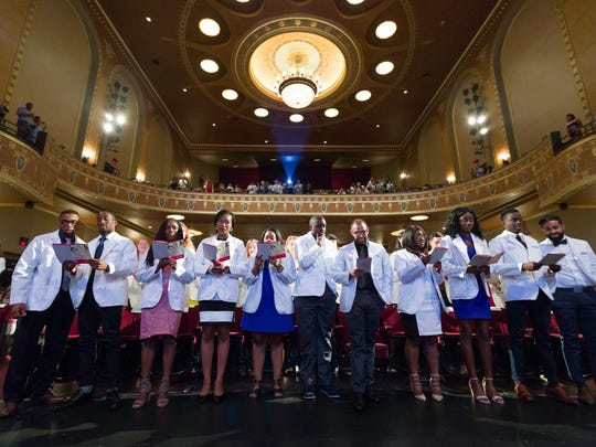 The Class of 2021 recites the Hippocratic Oath at the end of the White Coat Ceremony, officially commencing their journey to becoming physicians.