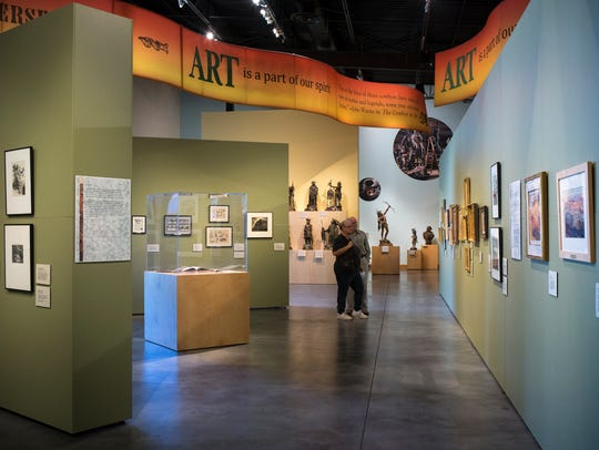 Visitors look at exhibits at the Western Spirit: Scottsdale's Museum of the West