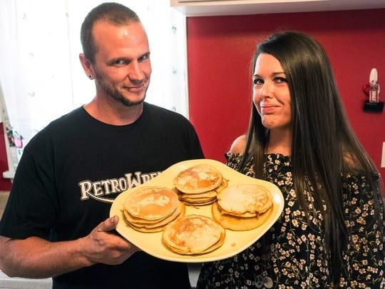 Erik Gunn and Amanda Hall open their Pleasure Ridge Park home to friends on Sundays to enjoy a pancake breakfast.