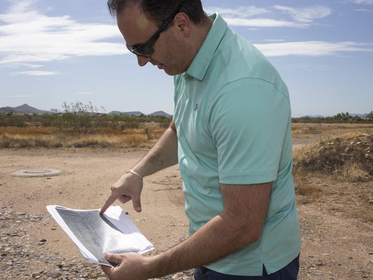 Simon Kreisberger stands at the site of his future