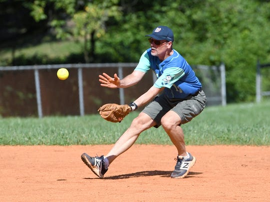 Roger Helm catches a ball in the infield during a game of Asheville Senior Softball at the Montford Recreation Complex on Thursday, Aug. 17, 2017.