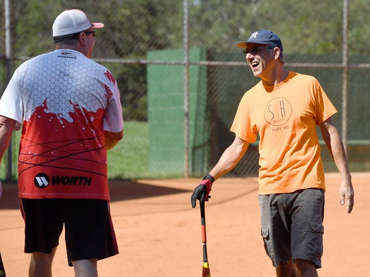 Randy Bowman, left, and Paul Gisondo laugh about a play during a game of Asheville Senior Softball at the Montford Recreation Complex on Thursday, Aug. 17, 2017.