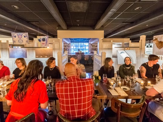Diners enjoy themselves at a private August 3rd Salonniere