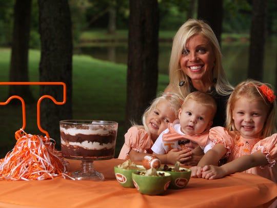 Layla Kiffin poses with her children, Pressley, Knox and Landry, and her favorite tailgating foods, Death by Chocolate, left, and Tennessee caviar, right, at the Cove in Concord Park on Aug. 12, 2009. Kiffin has since divorced Coach Lane Kiffin.