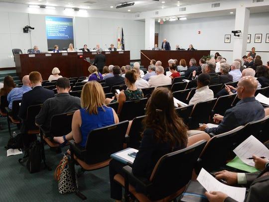 Members of the Brevard Legislative Delegation listen