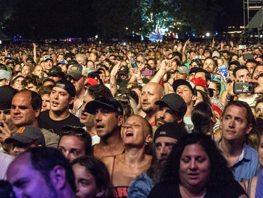 Die hard Eddie Vedder fans crowd the stage for the