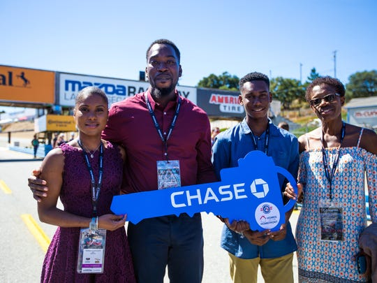 U.S. Army Staff Sgt. Toure Williams, center, was awarded a mortgage-free home in Jackson by Chase at Mazda Raceway Laguna Seca.
