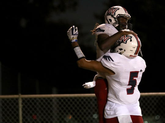Wakulla's Jaylon Worsham celebrates his rushing touchdown with Chris Beverly during their game against Leon at Cox Stadium on Thursday night.