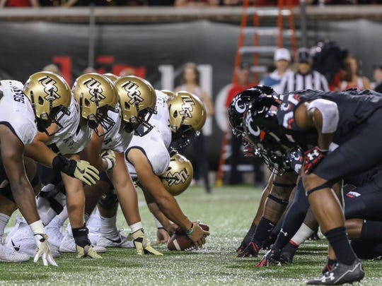 UCF lines up against UC's defense for a field goal during the UC vs. UCF Knights game at Nippert Stadium on Saturday Oct. 7, 2017.