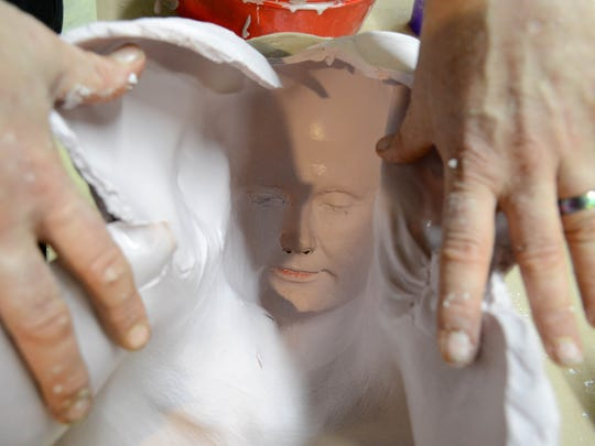 Alan Ostrander of AEO Studios shows Christina LaFortune's face in the lifecast  mold he just created.