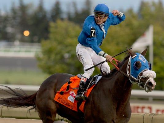 Toronto Ont.October 15 2017.Woodbine Racetrack.Pattison Canadian International .Bullards Alley Jockey Eurico Da Silva.WEG/michael burns photo