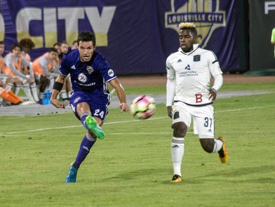 Louisville City FC's Kyle Smith works the ball toward