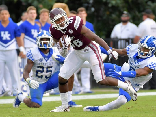 Mississippi State wide receiver Jesse Jackson (86) breaks a tackle by Kentucky cornerback Lonnie Johnson (6) as he rushes for yardage Saturday during the second half at Davis Wade Stadium.