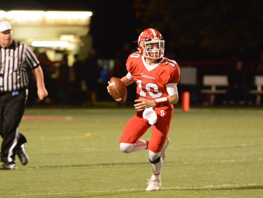 Susquehannock quarterback Hunter Sentz scrambles while looking for a receiver during the team's game against West York on Oct. 20, 2017. After beating the Bulldogs, the Warriors remained perfect in Division II play, setting up a potential Week 10 showdown with Dover for the outright championship in Division II. Bill Kalina photo