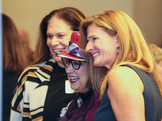 Current and former Women of the Year (from right) Lauren Hannan Schafer, Pam Kravetz and Tamara Harkavy pose for photos before the Women of the Year luncheon on Monday Oct. 23, 2017.