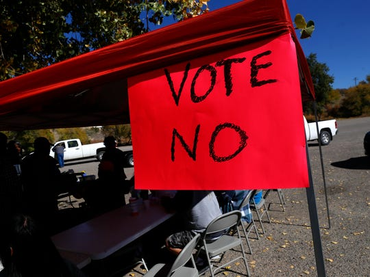 A group opposed to a proposed $216 million transportation stimulus plan sets up a booth to feed voters Tuesday at the Shiprock Chapter house.