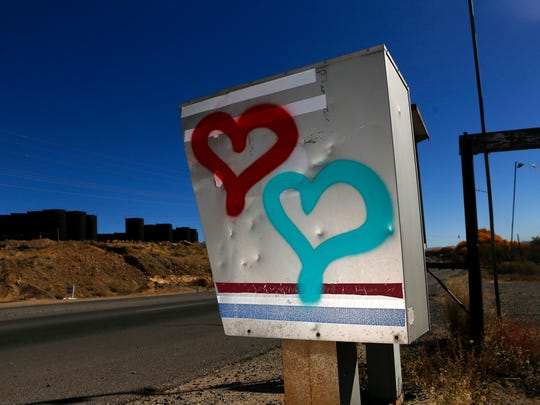The moniker 1 Love is pictured on a mailbox on Wednesday off U.S. 64 in Farmington.