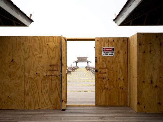 A temporary plywood wall prohibits the public from