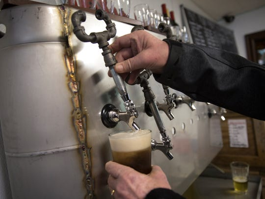 Mike Paschall, owner of 550 Brewing, pours himself