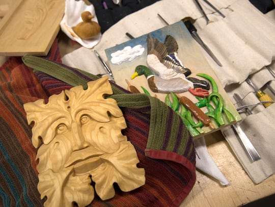 San Juan College Encore student Sybille Murphy's woodworking samples and tools are displayed Wednesday at San Juan College in Farmington.