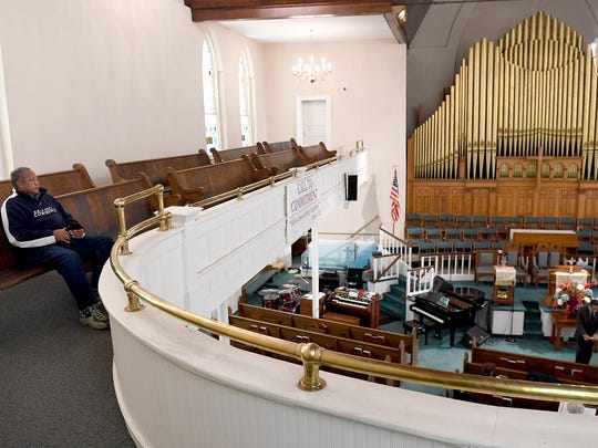 Deacon Bernard V. Oliphant stops to listen to part of the bible study service by Pastor Dr. John H. Grant from the balcony of the Mount Zion Missionary Baptist Church on Wednesday, Nov. 15, 2017. Oliphant is the chairperson of the church's security ministry which keeps the congregation as well as the church's building, including historic stained glass windows and organs, safe.