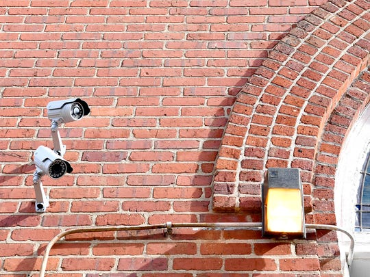 Two security cameras watch the door to the sanctuary of Mount Zion Missionary Baptist Church in downtown Asheville. The church has 13 security cameras that record in and around the building 24 hours a day.