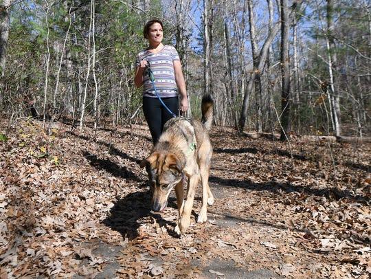 Bethany Adams walks Frida Bird through the Bent Creek