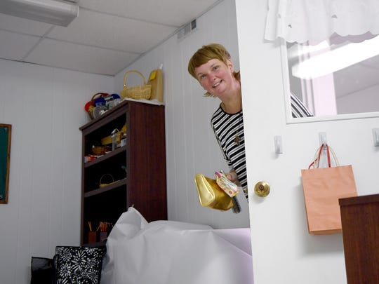 Katie Earl pokes her head into her room as she heads to the bathroom to get ready for bed at Grace Episcopal Church where she and about 10 other women were spending a week of nights with the Room in the Inn program on Thursday, Nov. 16, 2017.