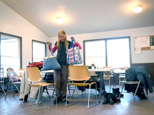Pam Pressley collects her belongings after taking a shower at the AHOPE day shelter before heading to a church to spend the night with the Room in the Inn program on Thursday, Nov. 16, 2017. Women in the program get to shower at the shelter, do laundry once a week and keep some of their belongings at the shelter where they meet each day before heading to a church to sleep.