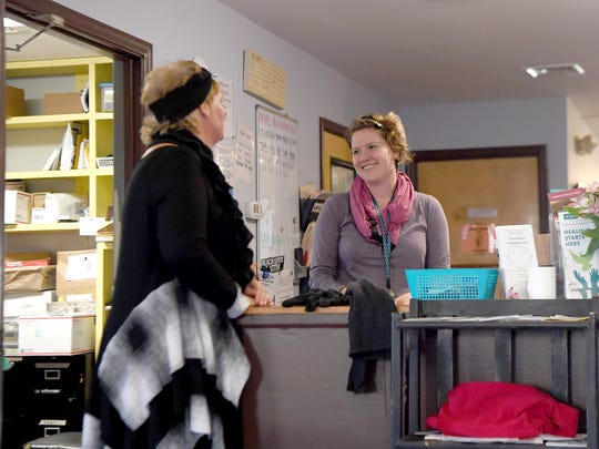 Katie Earl talks with Asia Heller, the Room in the Inn case manager at the AHOPE day center on Thursday, Nov. 16, 2017. Asheville's Room in the Inn provides case management to help the members meet their goals of staying in housing when they graduate from the program.