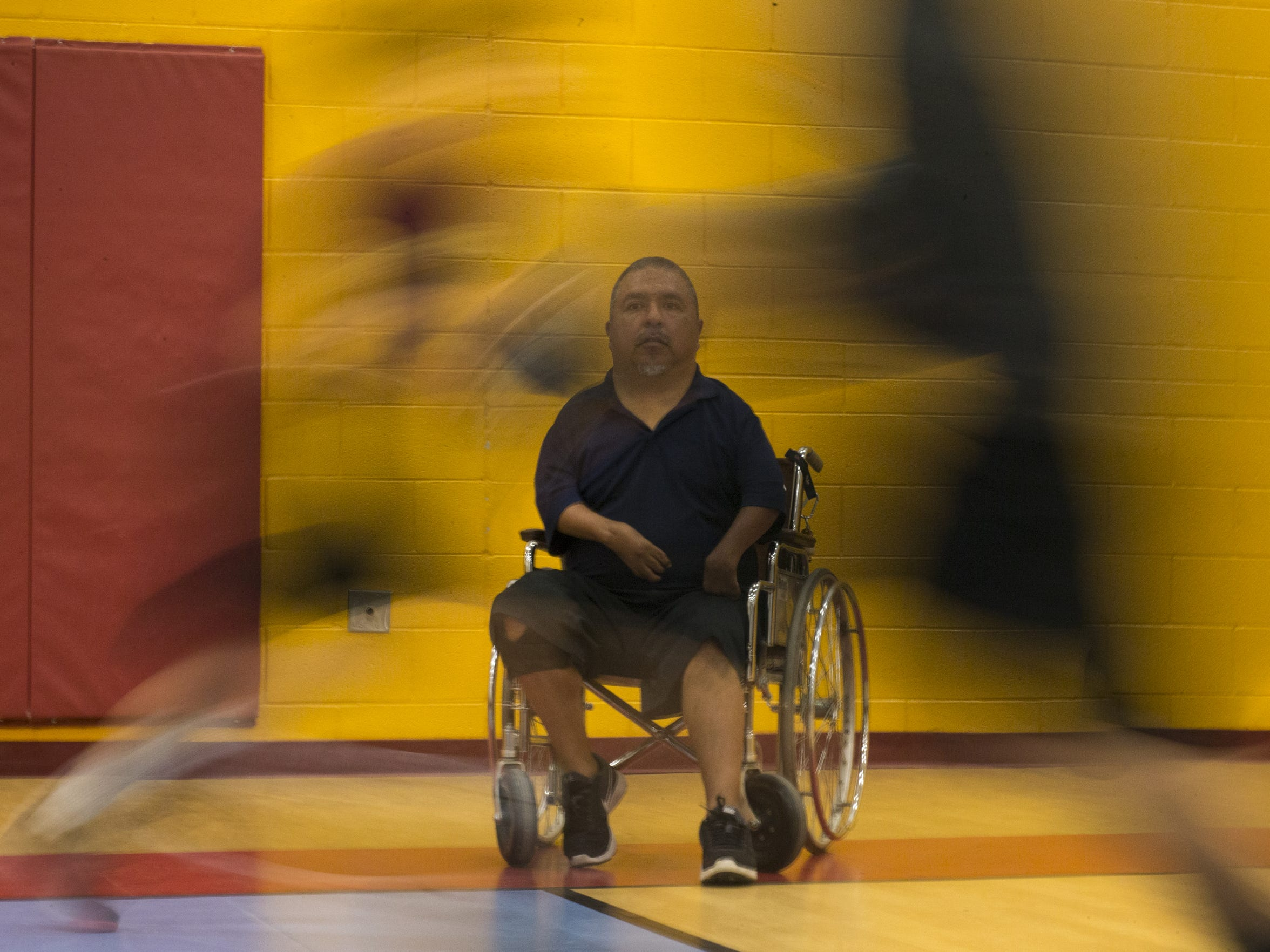 David Solano watches his team run a drill during basketball