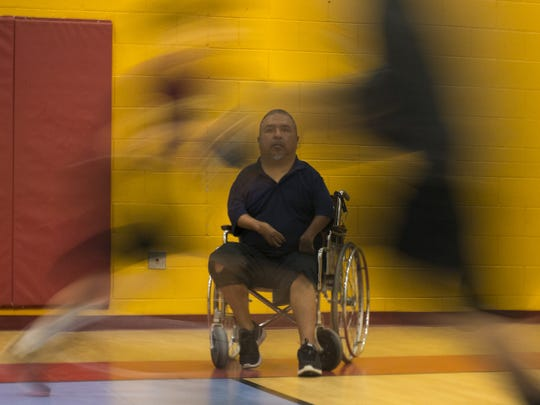 David Solano watches his team run a drill during basketball practice at Raul H. Castro Middle School in Phoenix.