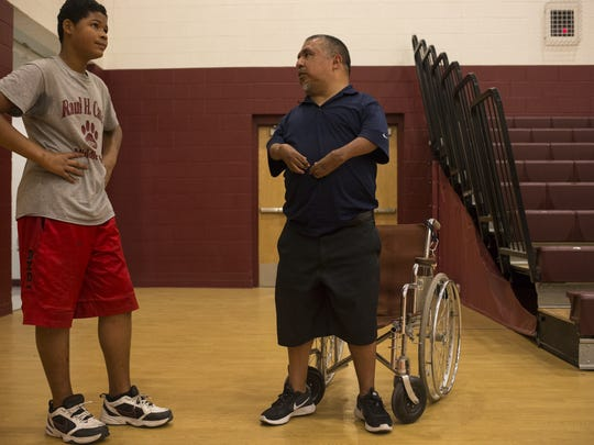 David Solano (center) talks with Brandon July at Raul H. Castro Middle School in Phoenix.